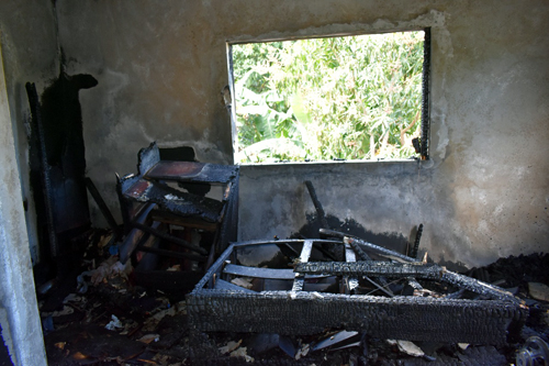 Three-y-o falls from burning building