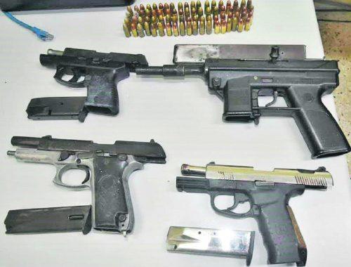 Guns found buried in cemetery